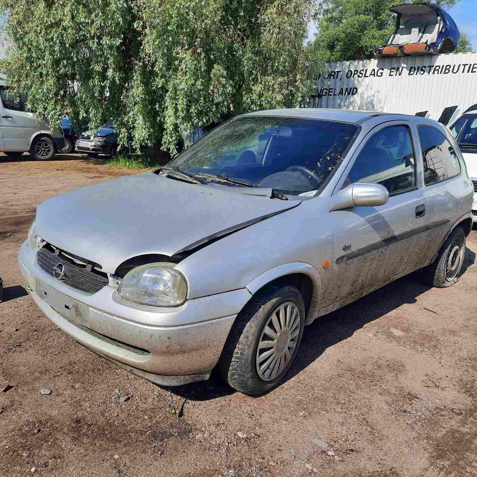Naudotos automobiliu dallys Foto 2 Opel CORSA 1999 1.5 Mechaninė Hečbekas 2/3 d. Pilka 2021-6-11 A6301
